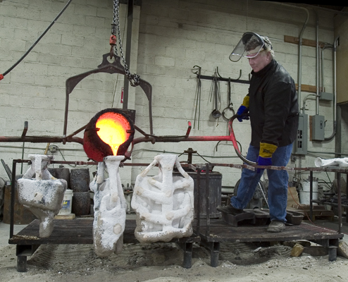 Art Foundry owner Alan Osborne demonstrates bronze casting of Nnathan Oliviera sculpture.